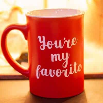 "Red mug with white lettering that says, ""you're my favorite"" which is a free SVG cut file"