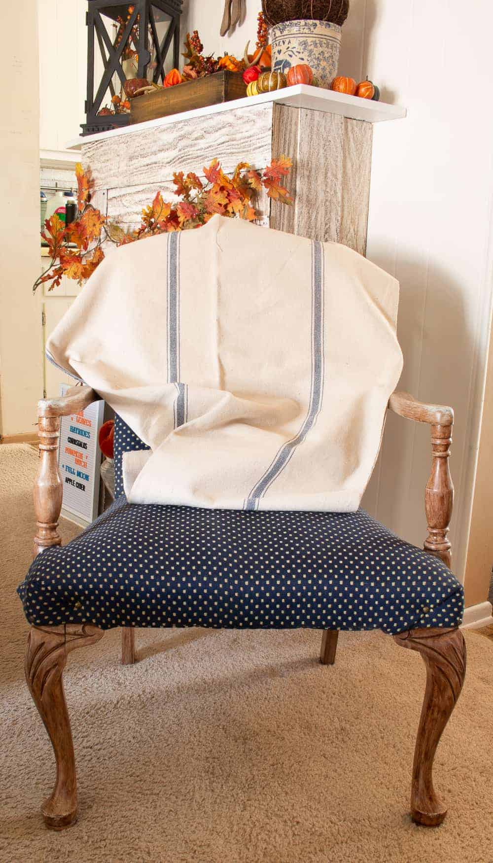 grain sac fabric draped over vintage fabric chair