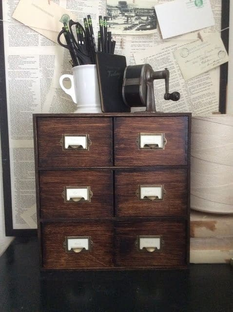 Ikea moppe updated with farmhouse style in brown stain with card catalog style pulls