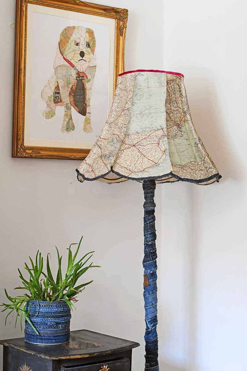 Lampshade made from old maps with the pole covered in recycled blue jean fabric
