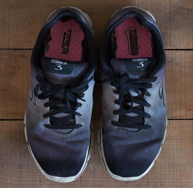 Black tennis shoes after cleaning to remove salt stains