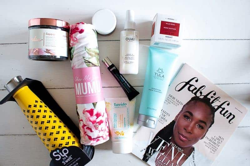 Contents from Spring 2019 FabFitFun Box on white table with overhead view