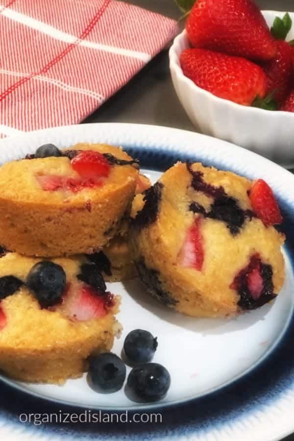 overhead view of sliced blueberry and strawberry muffins, patriotic food breakfast