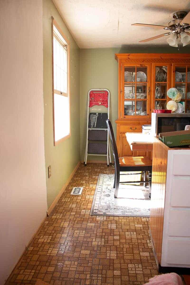 Long view of a kitchen dining room combo in a 1970's ranch style home before a cheap kitchen update - an under $1000 kitchen makeover