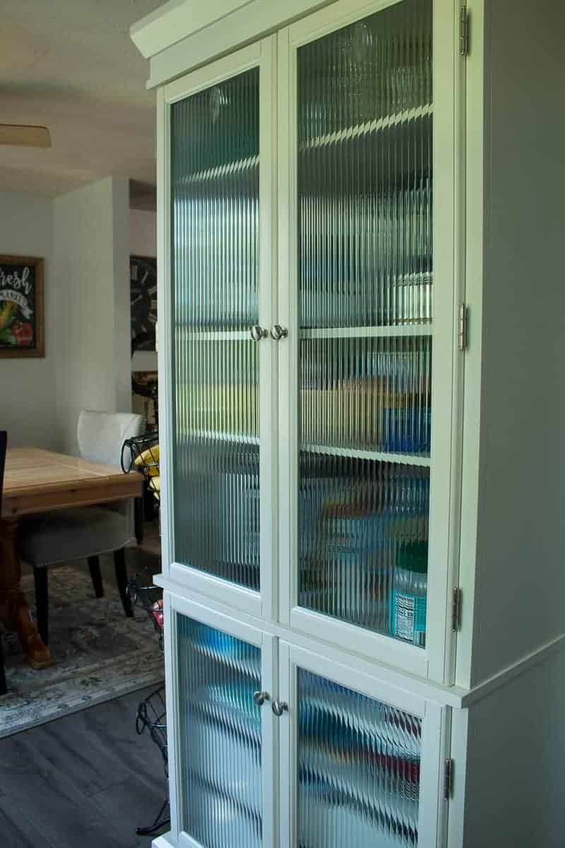 Side view of the new stand alone pantry from Wayfair as the after of the under $1000 kitchen makeover