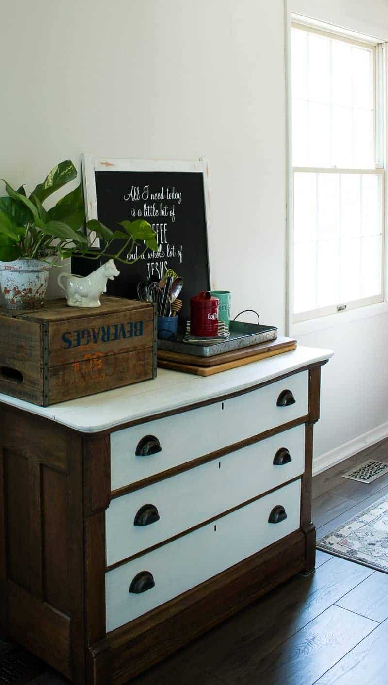 Side view of an antique dresser now used in a kitchen to hold silverware and baking supplies as part of a cheap kitchen update in this under $1000 kitchen makeover