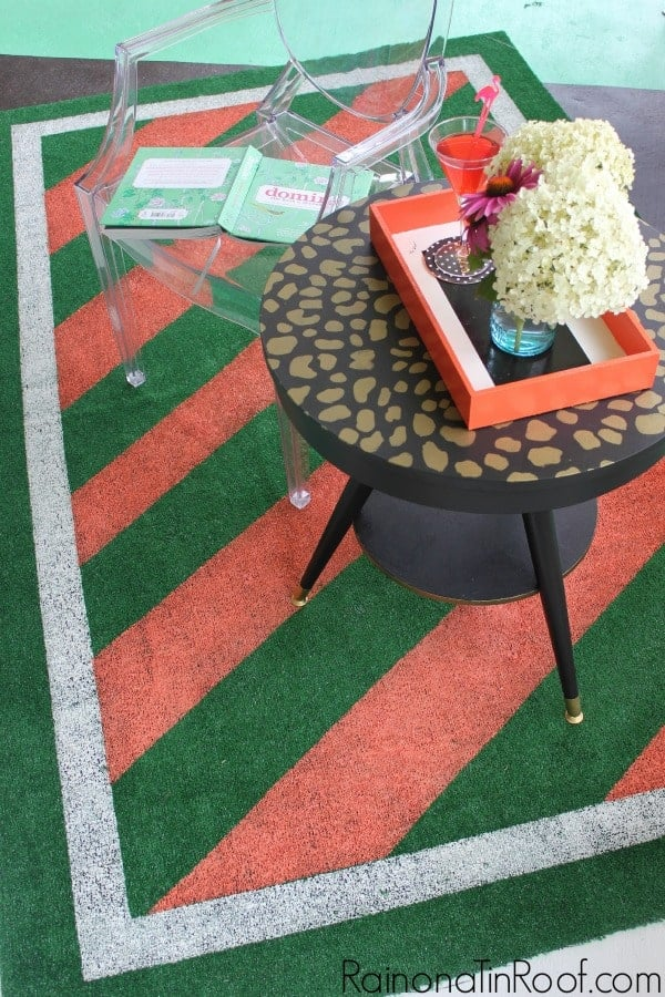 Side overhead view of an astroturf rug painted for decor