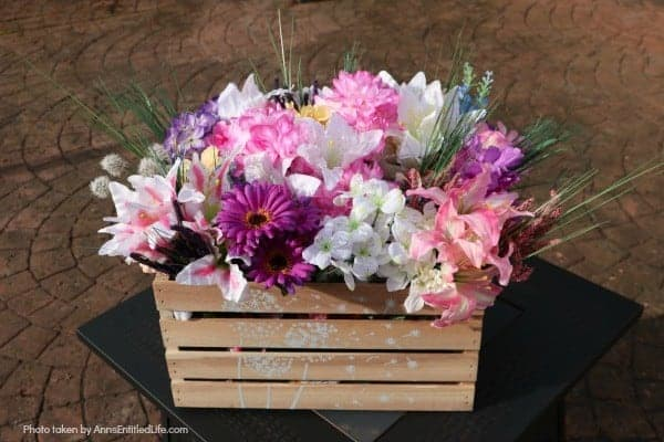 wooden crate filled with faux flowers