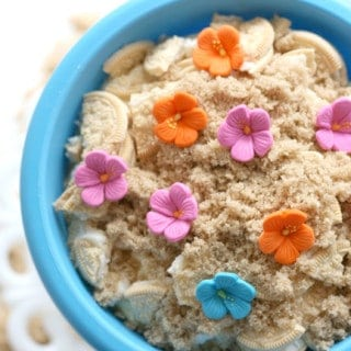 overhead view of oreo sand pudding in a blue beach pail
