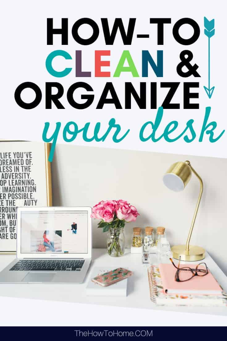 Clean and organized desk with pink flowers and a gold lamp