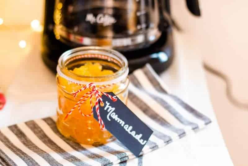 close up view of a pretty glass jar filled with orange marmalade