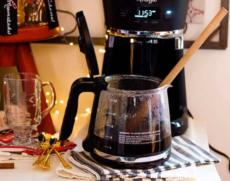 Christmas coffee being stirred with a wooden spoon