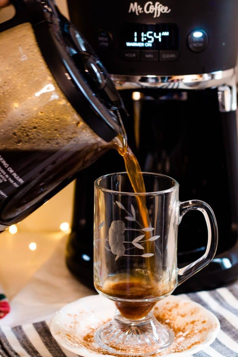 Coffee being poured into a Princess House glass coffee mug