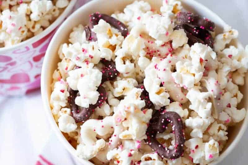 Overhead view of white chocolate popcorn in a popcorn pail