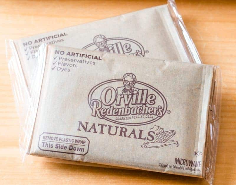 Overhead view of two packages of Orville Redenbacher's Gourmet popping corn in plastic wrap.