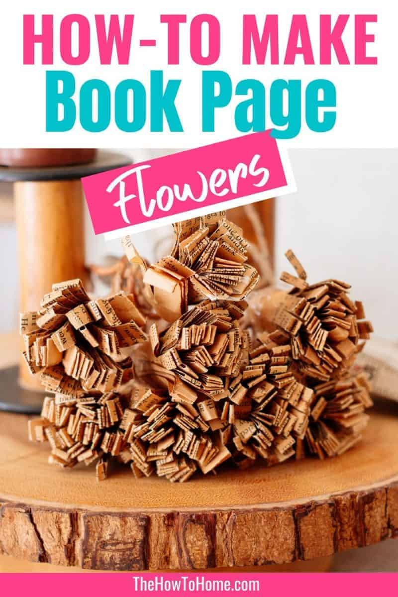 Bundle of book page flowers on a wooden cake stand