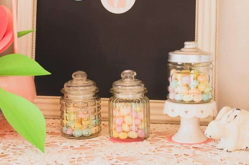 Three apothecary jars from the dollar tree filled with pastel candy