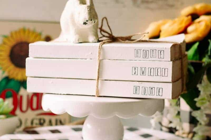 Stack of 3 books whitewashed and hand stamped.