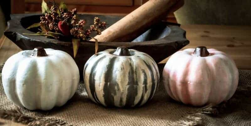 Painted dollar store pumpkins used for fall decor.