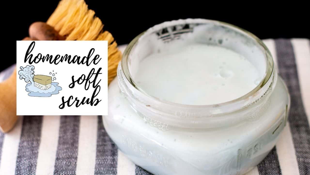 Homemade soft scrub in glass jar with scrubbing brush
