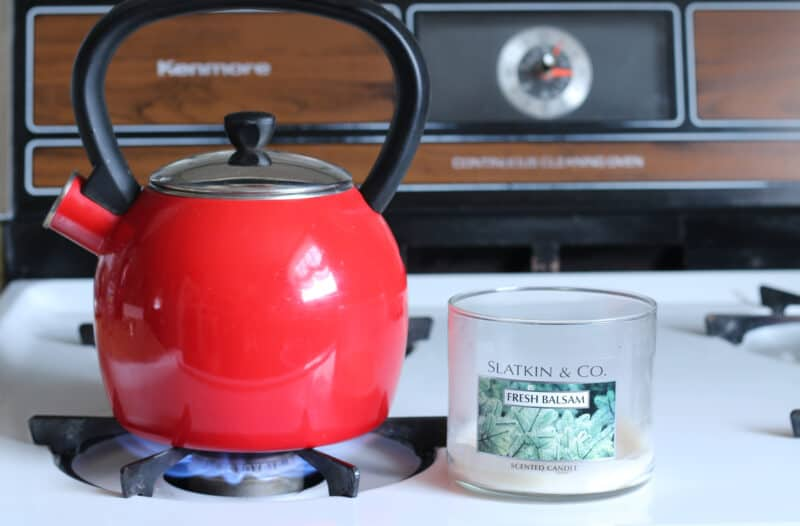red tea kettle and glass candle jar