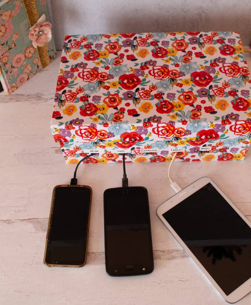 Shoebox covered with Pioneer Woman contact paper from Walmartused as a charging station
