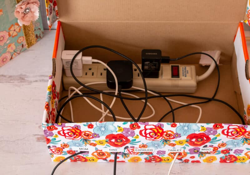 Charging Cords plugged in to a surge protector in a DIY Charging Station