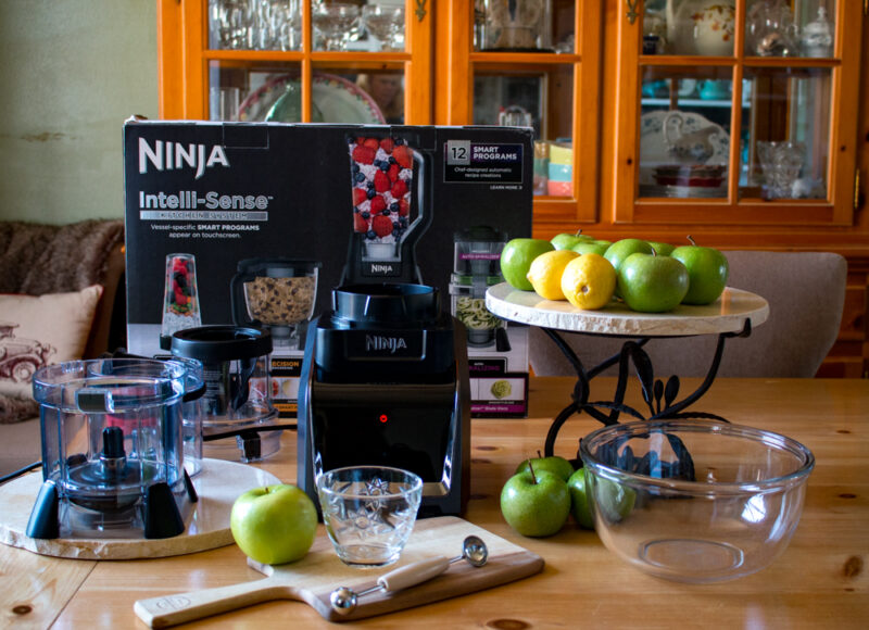 Marble platter with green apples and lemons, and a Ninja Intelli-Sense box and blender