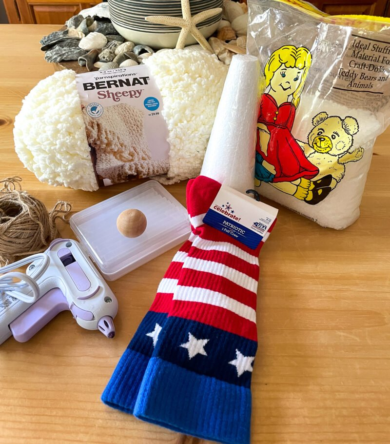 Overhead view of supplies used to make a Patriotic Gnome with a sock and a foam cone