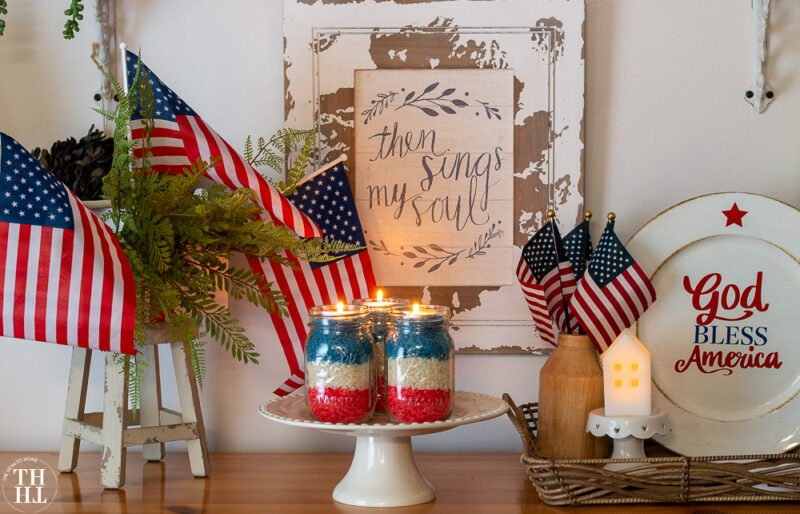 Red, White and Blue rice-filled mason jars topped with tealights - a festive 4th of July centerpiece