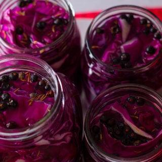 Overhead view of red cabbage sauerkraut in mason jars