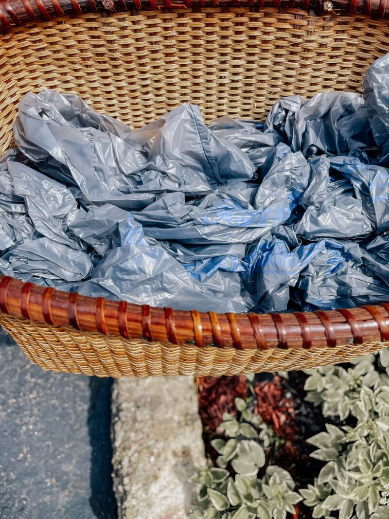 Scrunched up Walmart Bags used as cheap filled in a basket for an upcycled garden planter
