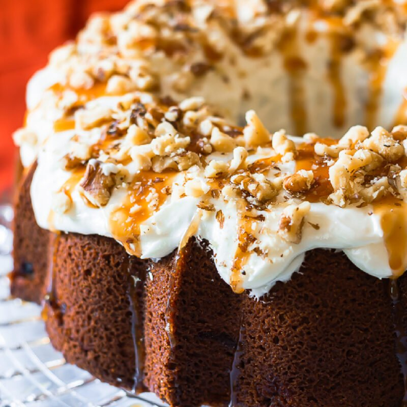 old-fashioned caramel pound cake with cream cheese frosting on a glass vintage cake plate