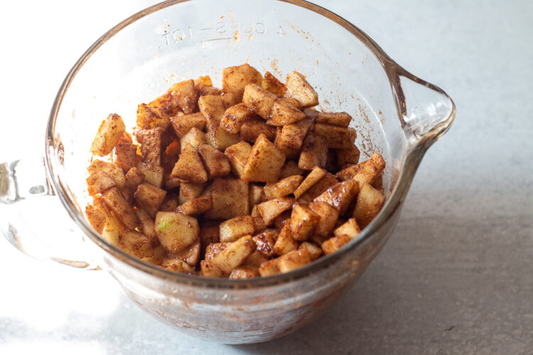 Granny smith chopped apples coated with cinnamon and brown sugar for filling for caramel apple pound cake