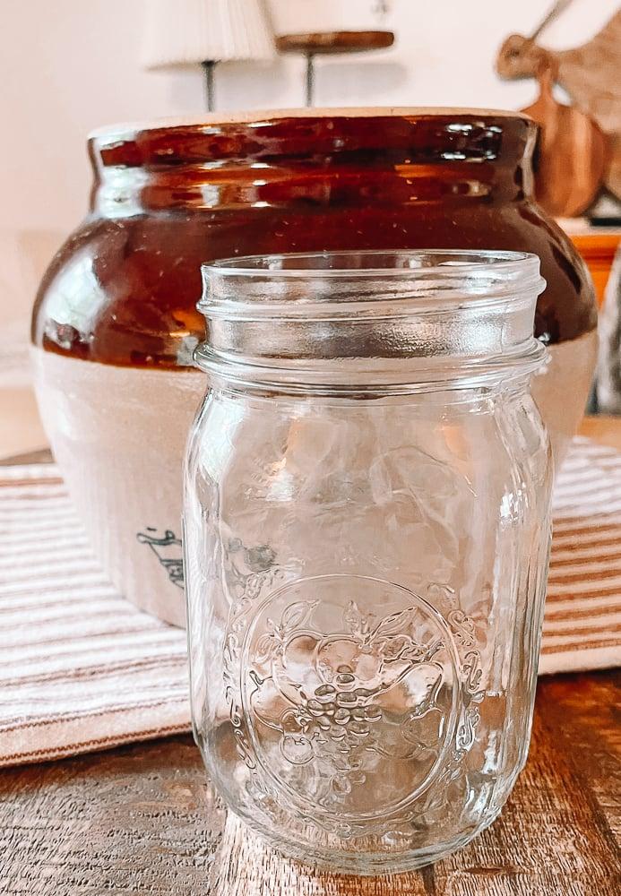 Mason Jar in front of vintage bean pot