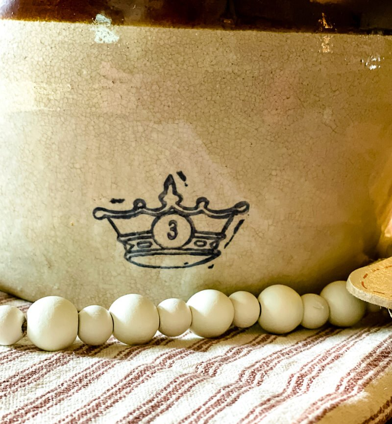 Close up of bottom half of vintage bean pot with crown and the number 3