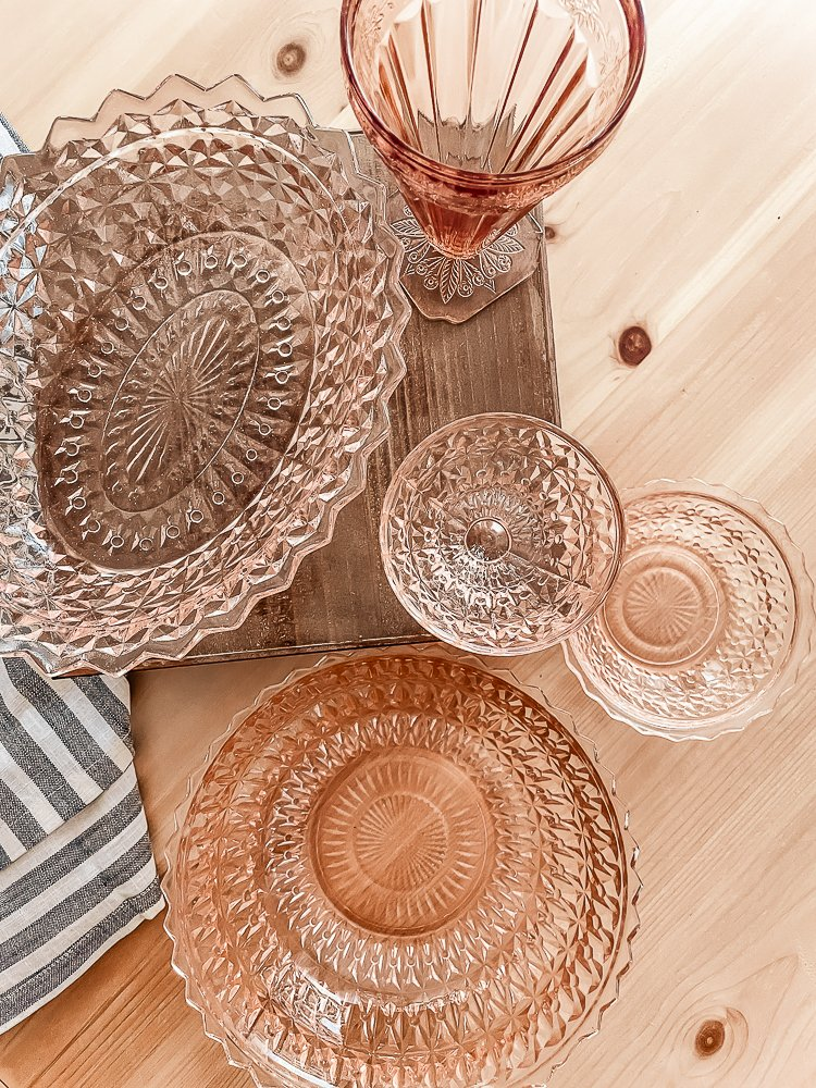 overhead view of 5 unique pieces of pink depression glass